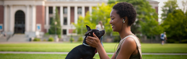 Playing with a dog in the MU Quad